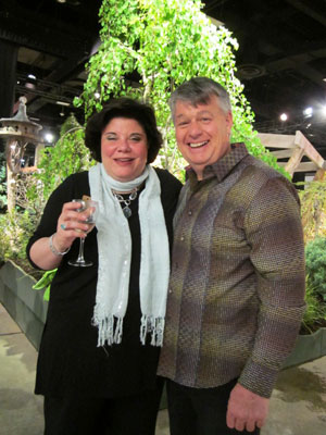 Carolyn Weston, Director of the Flower & Garden Show, congratulates Paul Miskovksy at the Preview Party regarding the LDC Award. Photo (c) Hilda M. Morrill