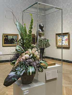 "A floral arrangement from Art in Bloom 2016 accompanies art object ""Little Fourteen-Year-Old Dancer"" by Edgar Degas (French, 1834-1917). Photo courtesy of Museum of Fine Arts, Boston."